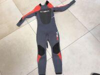 Children's kids wetsuit 4.3 size xxs aprox. Age 7