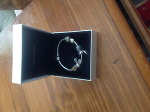 Like new Authentic Pandora bracelet and charms!
