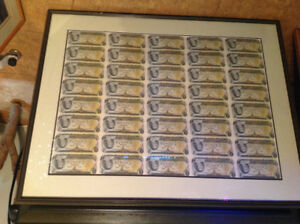 Uncut sheets of 1 dollar and 2 dollars bills framed