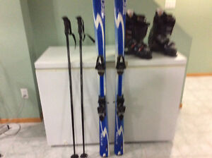 Skis/Boots/Polls