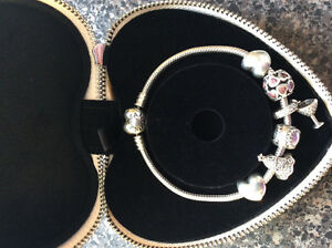 Pandora bracelet and 4 charms with heartshaped gift box