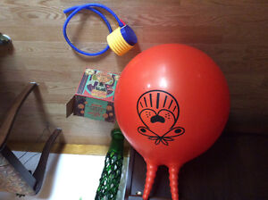 Child's ball with handles to sit and bounce on