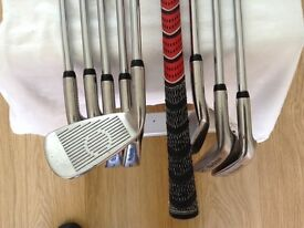 SET OF MACGREGOR DX OVER SIZE CAVITY BACK IRONS. RIGHT HANDED WITH MULTI-FLEX REGULAR STEEL SHAFTS.