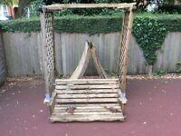 Wooden garden swing.