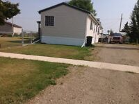 Bluesky. Mobile home on double corner lot for sale
