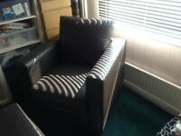 Brown. faux leather armchair with matching footstool