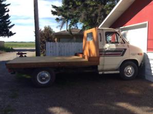 Chevy 1 Ton flat deck van.