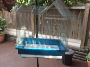 Nice bird cage in good condition. Stand available if needed