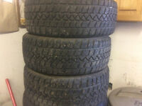 3 Studded 215/50R/17 inch tires