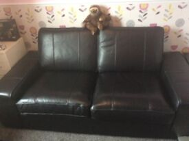 Two seater settee black leather as new