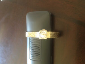 OMEGA VINTAGE LADIES WATCH,   ALL 14K GOLD EVEN THE CLOSURE.  VE