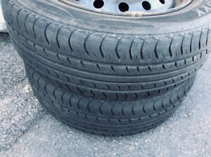 Set of four all season tires on steel rims