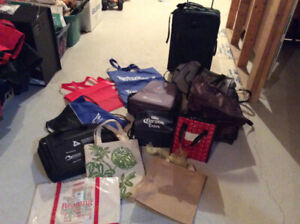 Various Carry bags, lunch bags and a suitcase