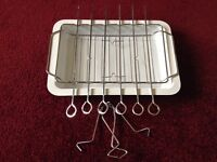 Camping caravan grill tray with skewers and chicken roasting rack