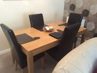 Dinning Table and 4 Leather Chairs