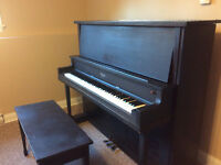 A upright piano with a matching bench