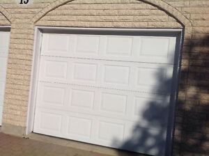 Garage door and hardware . White panel 9 by 7