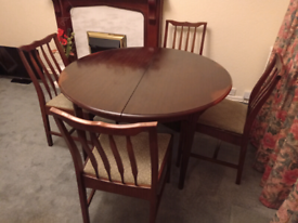 Stag extendable dining table with chairs.