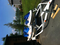 2 jetskis on double trailer and Seadoo Challenger