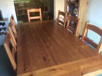 Solid acacia wood dining table and 8 matching chairs