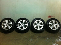 "set of 4 - 16"" Subaru Aluminum Rims with All season tires!"