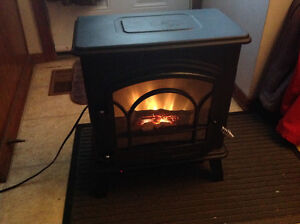 Nice small electric fireplace heater 1500 watt only 55 dollars