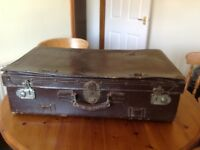 Large old brown leather suitcase