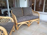 Conservatory cane two seater sofa and armchair