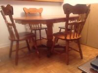 Dining room table with 4 chairs ($150).