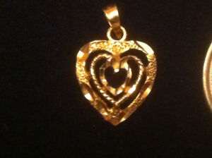 Gold yellow pendant [ marked 10K].