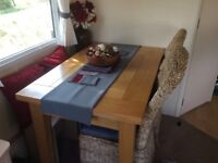Beautiful Oak Dining table and 2 x Wicker chairs