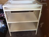 Baby changing unit with shelves