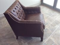 Two, rich brown leather arm chairs
