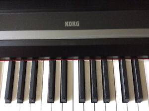 Korg digital keyboard, stand, case and stool