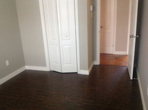 Beautiful, bright 3 bdrm main floor of house for rent April 1st