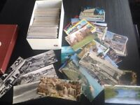 Old postcards- 5 boxes full of British and worldwide postcards.