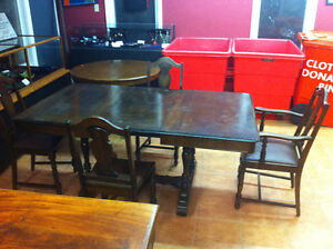 Antique butterfly leaf table with four chairs