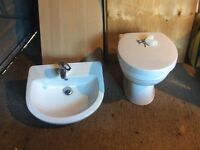 Toilet , basin tap and pop up waste