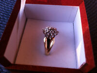 10 KT Solid Yellow gold women's ring ..with two diamonds.
