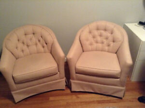 Two lovely upholstered bucket chairs