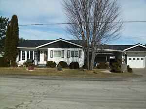 A MUST SEE! SPACIOUS OPEN CONCEPT 2BR 2BA+GARAGE+DECK+METAL ROOF