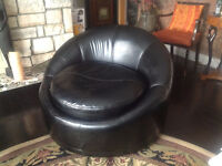Italian Designed Brown Leather Over sized Tub Swivel chairs.