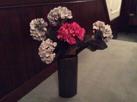 Tall brown vase and artificial hydrangeas