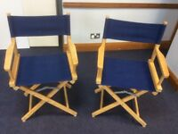 Pair of Directors chairs with blue fabric seats and backs.