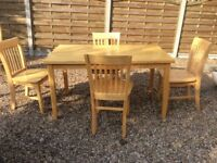 Table and 4 chairs. Honey Coloured heavyweight wood possibly mango
