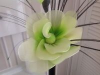 Tall black vase with lime green artificial flower arrangement