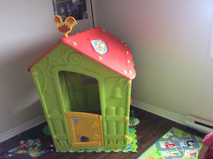 Unique playhouse with floor mat
