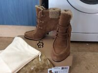 Genuine UGG boots size 5, never worn