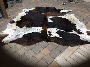 Cow Hide Rug   approximately 80 in x 80 in    $100.00