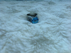 Elegant 10k white gold ring with blue topaz, and cubic zircons